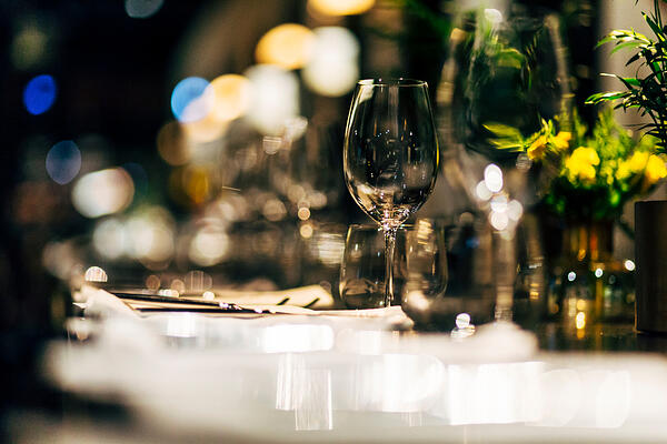 restaurant table with wine glass