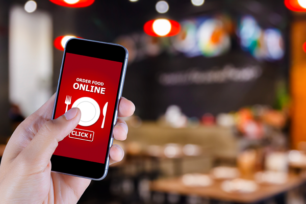 Man using iphone to order food online