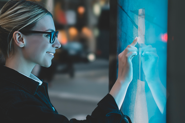 Women using a a Self-Ordering Kiosks