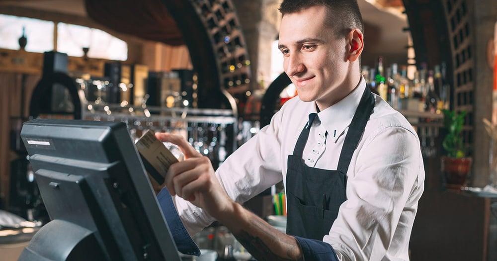 Restaurant staff using a pos system terminal
