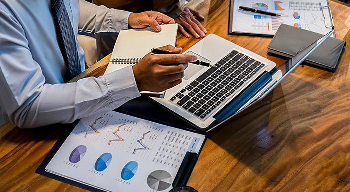 multi-site management laptop on desk