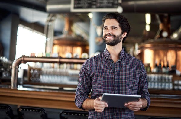 restaurant manager with tablet pos
