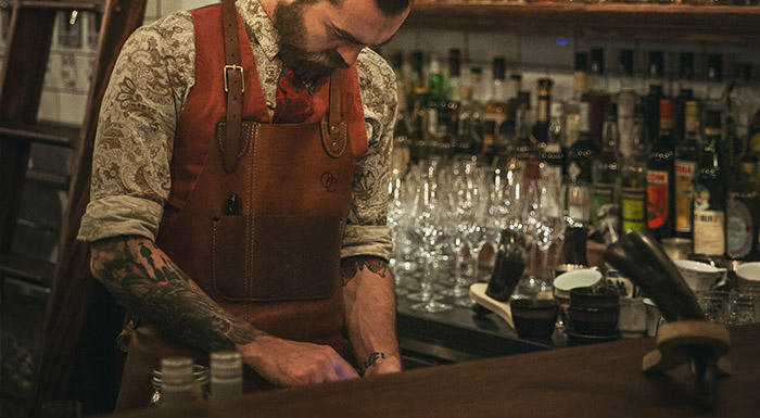 Bar manager checking wastage and usage