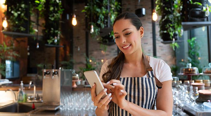 Waiter entering stock on iphone