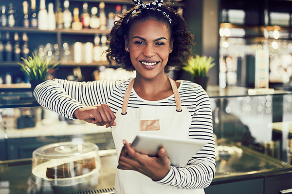 A restaurant staff member using a POS tablet