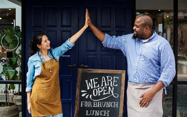 restaurant staff high five when opening up